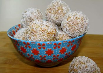 Balls of Caramel, Cream and Vanilla Cake Rolled in Coconut