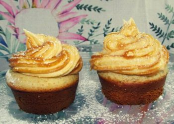 Vanilla Cupcakes Topped with a Swirl of Caramel Cream Cheese Icing